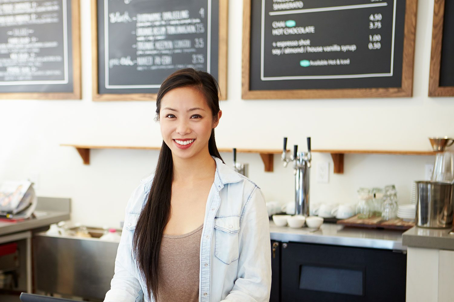 Young Smiling Woman Working At A Coffee Shop